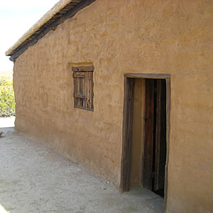 Adobe station house